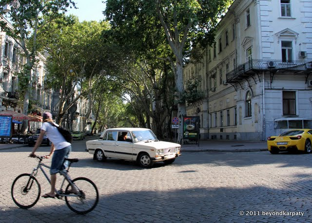 A typical Odessa street, with bicycle, Lada and Ferrari