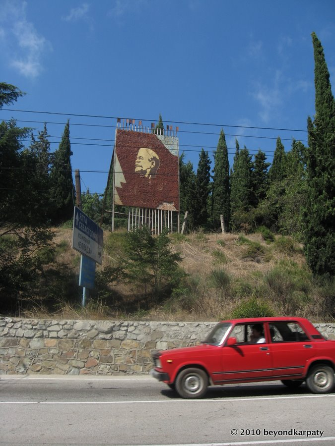 A view of the main Yalta-Simferopol highway with Lenin mosaic and overhead trolleybus cables.